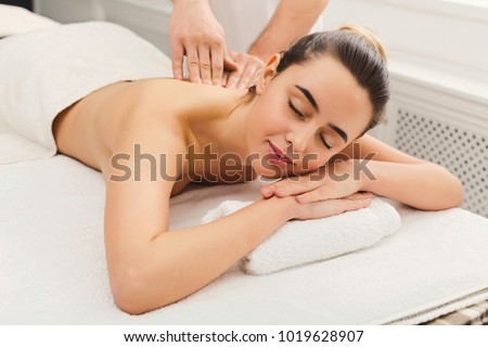Classical neck and back massage, closeup. Woman enjoying spa treatment at salon. Wellness, beauty and health care concept