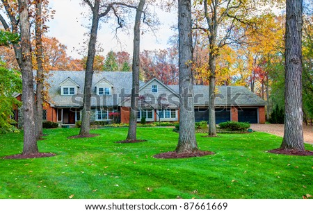 Classical North American Residential House in Wooded Area in Fall Season
