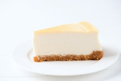 Classical Plain Cheesecake Slice On White Plate Isolated On White Background