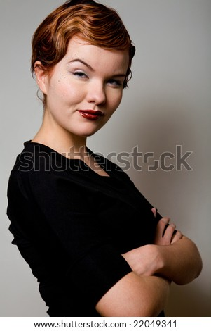 Classical portrait of lovely red-head young woman with dollar sign on face