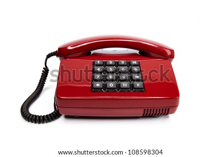 Classical red telephone from the eighties, isolated on a white background