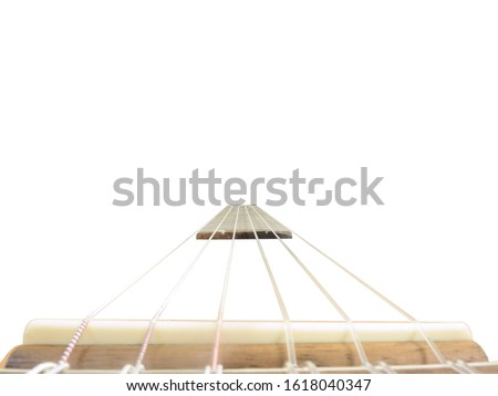 Classical six strings acoustic guitar neck with nylon strings perspective view isolated on white