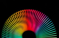 Classical slinky spring toy isolated on the white background