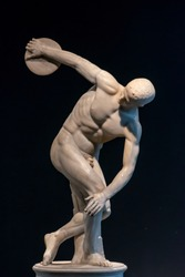 Classical statue of greek athlete throwing a discus