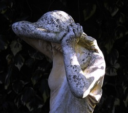 Classical Stone Statue of a Beautiful Woman in Sadness
