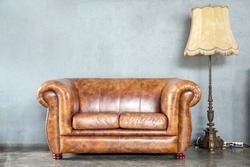 classical style Armchair sofa couch in vintage room with desk lamp