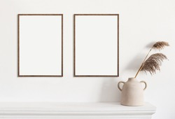Classical style interior with poster artwork mock-up. Blank white empty picture frame mockup on white wall. Modern scandinavian interior with poster artwork template. Blank empty copy space frame
