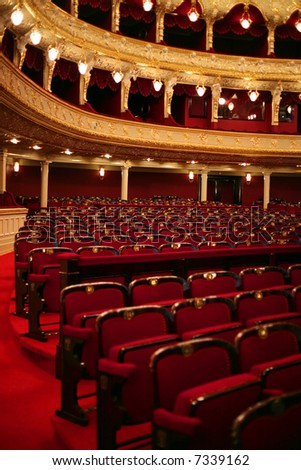 Classical theater interior with red seat and number