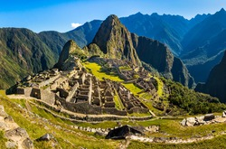 Classical view over Inca city of Machu Picchu, just after sunrise. Near Cusco, Peru. Unesco World Heritage site, one of the new wonders of the world.