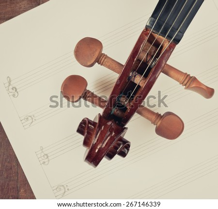 classical Violin headstock closeup on blank Music sheet + vintage filter for music composer concept background