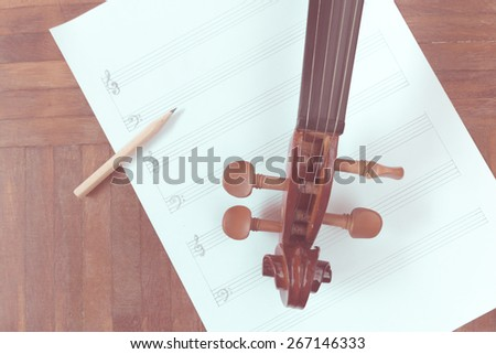 classical Violin headstock & pencil on blank Music sheet + vintage filter for music composer concept background