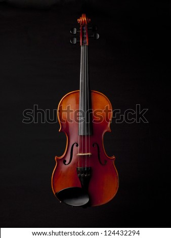 Classical violin isolated in a black background - stock photo