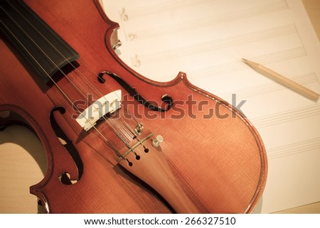 classical Violin on blank Music sheet, soft & dramatic tone processed for music composer concept background