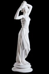 Classical white marble statue of a woman with vase isolated on black background
