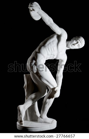 Classical white marble statue of naked discus thrower isolated on black background