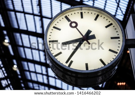 classicistical railway station.Clock in railway station.Clock in railway station, Big old, vintage clock hang with roof of Train station. Belgium, Antwerpen. #1416466202