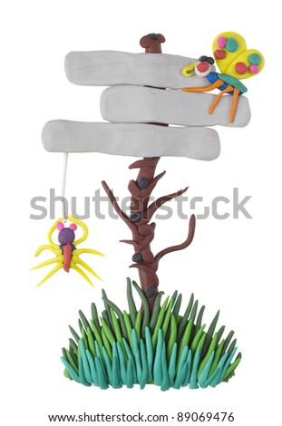 Classified ads for advertising billboard with a spider and a butterfly made from  plasticine clay. Children collage. Isolated with patch