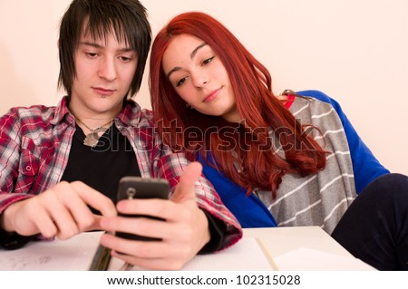Classmates using a smartphone to search for content