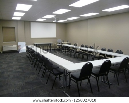 Classroom setup with a setup for board room or conference