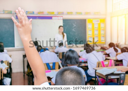 Classroom with students intending to study. Students who have math problems, Students have questions by raising and teachers.