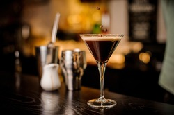 classy bartender garnish martini espresso cocktail drink foam coffee bean on top bar counter