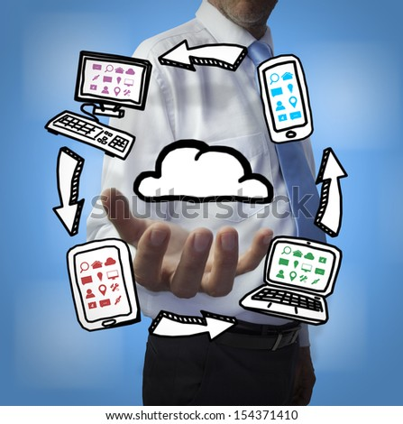 Classy businessman holding cloud computing drawings on blue background