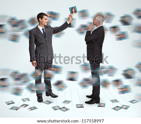 Classy businessmen working together holding profile picture