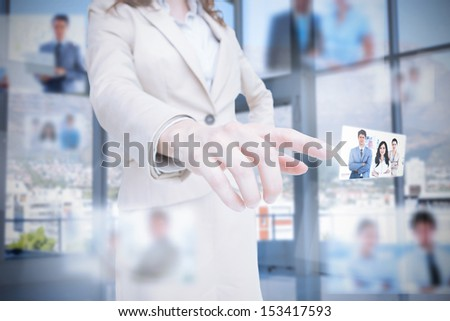 Classy businesswoman presenting coworkers pictures on digital interface #153417593
