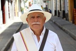 Classy Colombian elder man outdoors