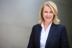 Classy distinguished blonde business woman professional executive attorney in a modern suit