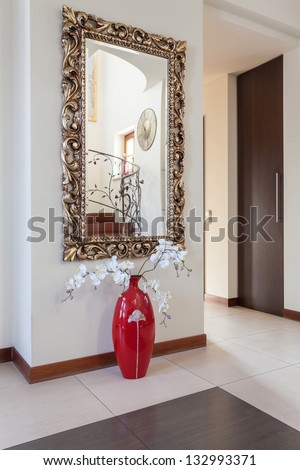 Classy house - decorative mirror and a flower
