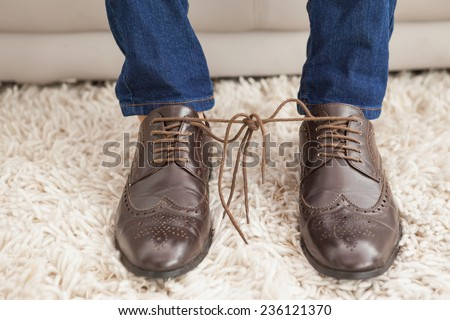 classy mans shoelaces tied...