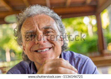 classy mature man with broken tooth smiling #1136146721