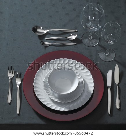 classy place setting on dark table cloth seen from above