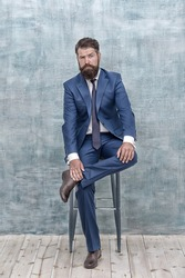 Classy style is timeless. Stylish businessman sit on chair. Bearded man in formal style. Professional wardrobe. Business dress code and formalwear. Fashion style. Real man real style, vintage filter
