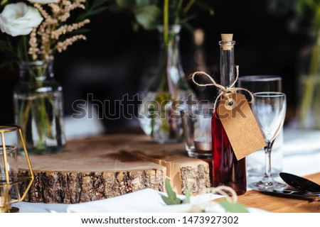 Classy wedding setting.Table setting. Fancy bottle with empty name tag.