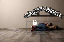 Claustrophobia. Scared little girl feeling in closed space and crying