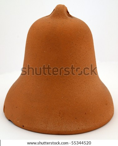Clay bell by hand on a white background.