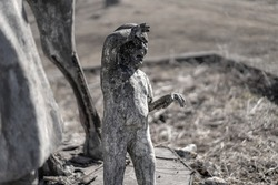 Clay boy in the form of a monument