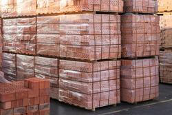 clay brick stored for building construction. Industrial production of bricks. brick production line in factory, stacked bricks