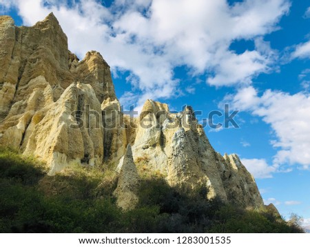Clay Cliffs geological formation in New Zealand #1283001535