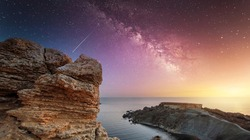 Clay Cliffs in Malta. Cliff on the background of the Milky Way. Landscape with Milky way galaxy. Sunset and and bright milky way galaxy.