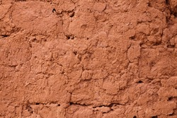 clay earthen wall texture background red - stock image