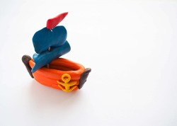 Clay figure: boat on white background. Selective focus
