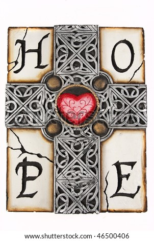 Clay grey cross with intricate details with a red heart on the cross section, with the word HOPE spelled around it