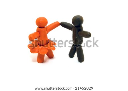 Clay human figures dancing isolated on white background
