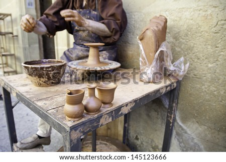 Clay manual worker, detail of a clay artisan