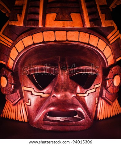 clay mask of a maya in the dark, end of the world