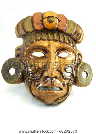 stock photo : Clay mask of a Maya warrior with tattoos and ear spools.