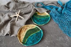 Clay plates, handmade bowls in wabi sabi style. Handmade ceramic dishes. Clay dishes. Ecology concept.Eco dishes